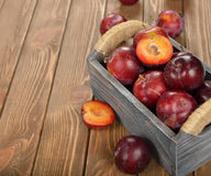 Fresh plums in a wooden box Stock Image