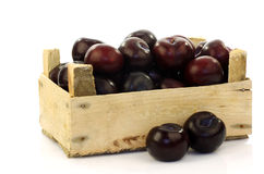 Fresh plums in a wooden crate Royalty Free Stock Images