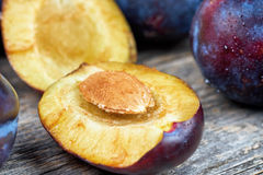 Fresh plums. On a wooden table Royalty Free Stock Images