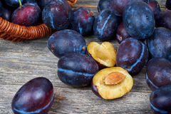 Fresh plums. On a wooden table Royalty Free Stock Image