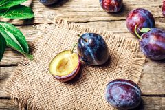 Fresh plums on wooden table.  Stock Images