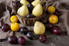 Fresh plums on wooden table Royalty Free Stock Images