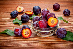 Fresh plums on a wooden table Royalty Free Stock Photo