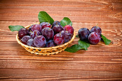 Fresh plums on a wooden table Stock Photos