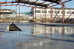 Fresh polished concrete slab and metal construction Stock Photo