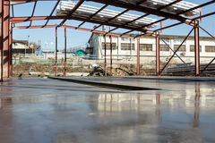 Fresh polished concrete slab and metal construction Royalty Free Stock Photos