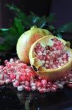 Fresh Pomegranate on Black Background Stock Images