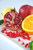 Fresh Pomegranate with Colorful Fruits on Background Stock Photography