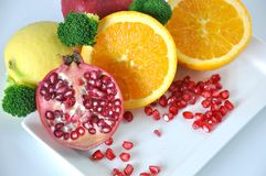 Fresh pomegranate with Colorful Healthy Fruits Stock Photography