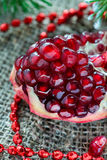 Fresh pomegranate with festive decorations Royalty Free Stock Photography