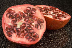 Fresh Pomegranate fruit. Halved fresh pomegranate fruit on water drop Stock Image
