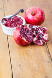 Fresh pomegranate fruit and pips in white bowl Stock Images