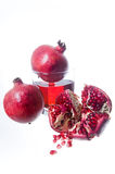 Fresh pomegranate fruits and juice Royalty Free Stock Photos