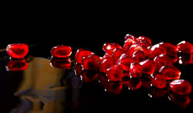 Fresh pomegranate grains. Pomegranate seeds on a dark background Royalty Free Stock Photos