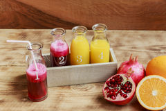 Fresh pomegranate juice and orange squeeze Royalty Free Stock Photos