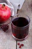 Fresh pomegranate juice Stock Photography