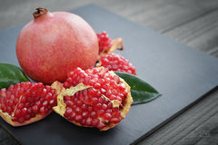 Fresh pomegranate with leaves Stock Photo