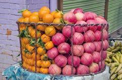 Fresh pomegranate and orange fruits in asia market Stock Photos