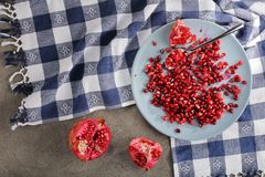 Fresh pomegranate seeds on a plate royalty free stock photos