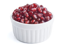 Fresh pomegranate seeds in white bowl Stock Photo
