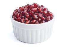 Fresh pomegranate seeds in white bowl Stock Photo