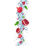 Fresh pomegranate with water splash. Royalty Free Stock Photos