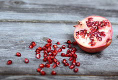 Fresh Pomegranate on wood background closeup Royalty Free Stock Images