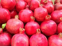 The fresh pomegranates appeared on the juice stand. The Armenian fresh pomegranates appeared on the juice stand royalty free stock photos