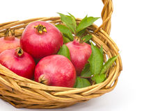 Fresh pomegranates. In a basket royalty free stock image