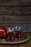 Fresh pomegranates and juice on copper plate. On wooden background. Free space for text. Place for wording Stock Photo