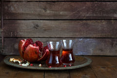 Fresh pomegranates and juice on copper plate. On wooden background. Free space for text. Place for wording Stock Images