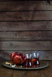 Fresh pomegranates and juice on copper plate. On wooden background. Free space for text. Place for wording Royalty Free Stock Photography