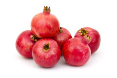Fresh pomegranates. On white background stock images