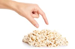 Fresh pop corn in hand isolated on white background Royalty Free Stock Photo