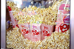 Fresh popcorn -closeup. Freshly popped corn in bags and boxes are handheld favorites at movies and fairs Stock Photos