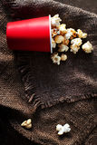 Fresh Popcorn in a red cardboard box on the wooden table, Cinema Stock Photography