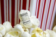 Fresh popped popcorn with nutritional label Stock Photography