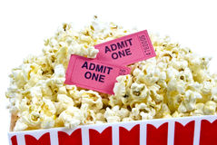 Fresh Popped Popcorn With Tickets Close Up. Horizontal close up shot of fresh popped popcorn with two movie tickets.  On white background Royalty Free Stock Photos