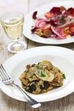 Fresh porcini mushroom risotto. And radicchio rosso salad Stock Photo