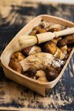 Fresh porcini. Mushrooms in a basket, wooden background Royalty Free Stock Photo