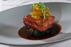 Fresh pork belly over collard greens Royalty Free Stock Photography
