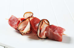 Fresh pork chunks and bacon on stick Stock Images