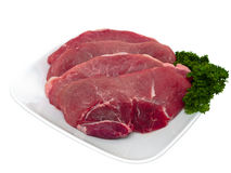 Fresh pork cuts global view in plate. On pure white background Royalty Free Stock Photo