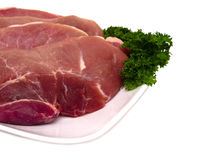 Fresh pork cuts in plate closeup view Royalty Free Stock Image