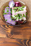 Fresh pork fat, with red hot chili peppers, green and purple onions. And  peas allspice beautifully laid out on a glass plate on the background of old boards Stock Photos