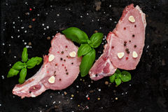 Fresh pork loin chops with spices and basil Stock Photos