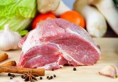 Fresh pork meat on  cutting board. Fresh pork meat on a cutting board Royalty Free Stock Photography