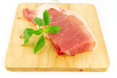 Fresh pork meat on a cutting board. On white background Stock Images