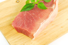 Fresh pork meat on a cutting board. On white background Stock Photography