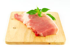 Fresh pork meat on a cutting board. On white background Royalty Free Stock Photography
